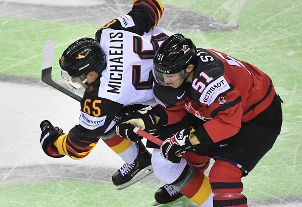Stone hat trick helps Canada cruise past Germany at world