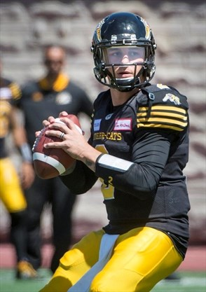 cc814be9e Hamilton Tiger-Cats quarterback Johnny Manziel looks for an open receiver  Saturday in Montreal against the Alouettes. - Peter Mccabe