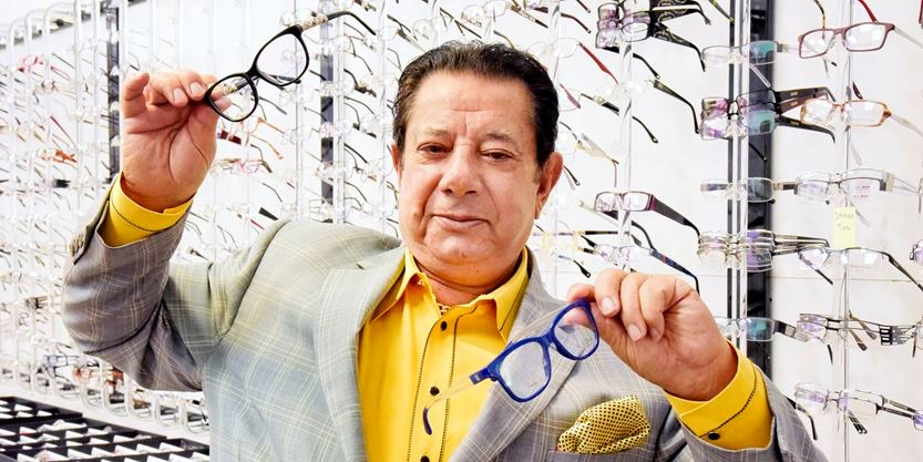 96c3cf64f7 Hakim Optical founder Karim Hakimi displays some glasses frames in his  personal office showroom on March 29. - Staff Metroland
