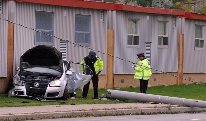 Crash near St  Mary's High School in Kitchener sends three