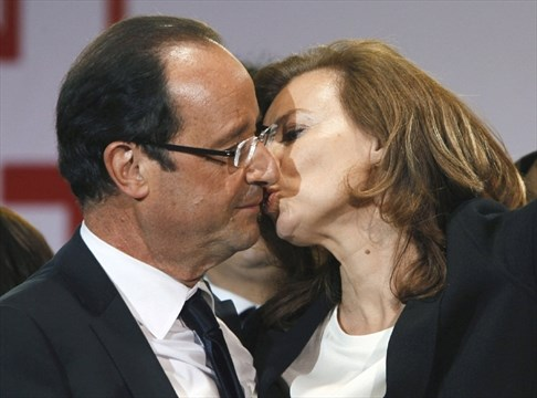 French president threatens legal action over magazine photos file this sunday may 6 2012 file photo shows french president elect francois hollande kissing his companion valerie trierweiler after greeting crowds m4hsunfo
