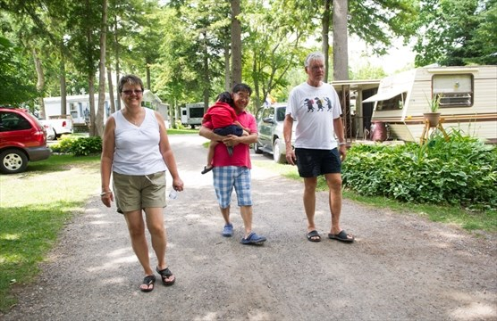 Diane Bilton Left And Her Husband Brian Right Walk With Frank Chan His Son Jee Gu Back To Their Mobile Homes In Green Acre Park Waterloo