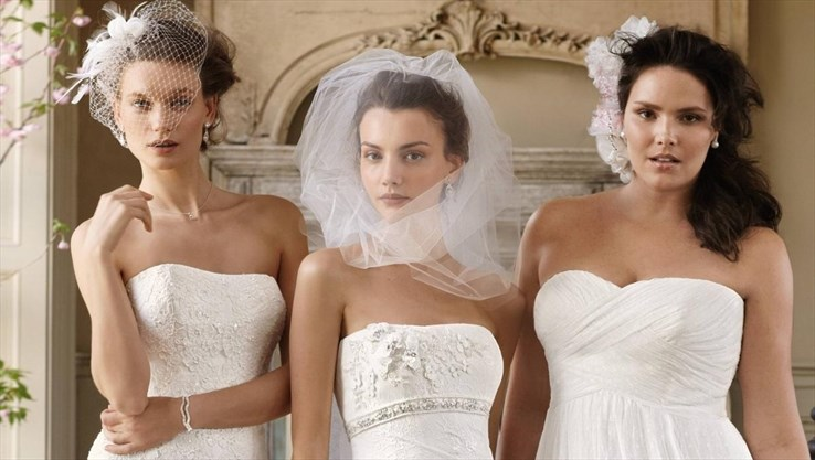 9c66f2be97 Models show off dresses from Hamilton s David s Bridal in this Spectator  file photo. The experience is practically impossible to avoid
