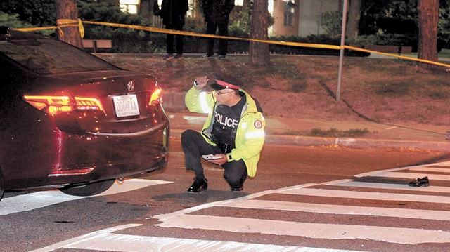 A Toronto Police Officer Investigates At The Scene Of Pedestrian Struck Accident On Park Home Avenue Intersection With Beecroft Road