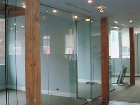 The Beauty And Function Of Glass Walls In Your Office Space