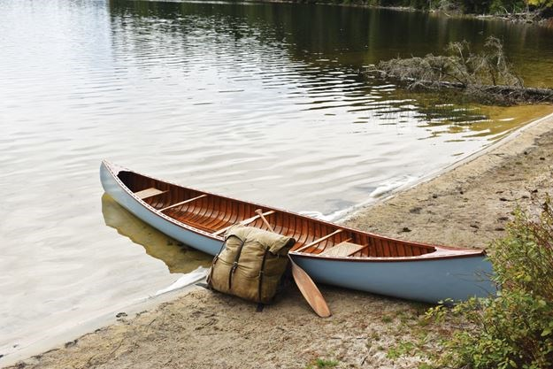 The canoe maker's personal canoe is a light blue 1939 Old Town. He bought it from a customer who didn't want to pay to have it fixed. Cook restored it and made it his. - Brian Cook