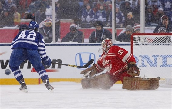 3d8dc6400a4 Toronto Maple Leafs center Tyler Bozak (42) scores the winning goal past  Detroit Red Wings goalie Jimmy Howard (35) in the shootout during the 2014  Winter ...