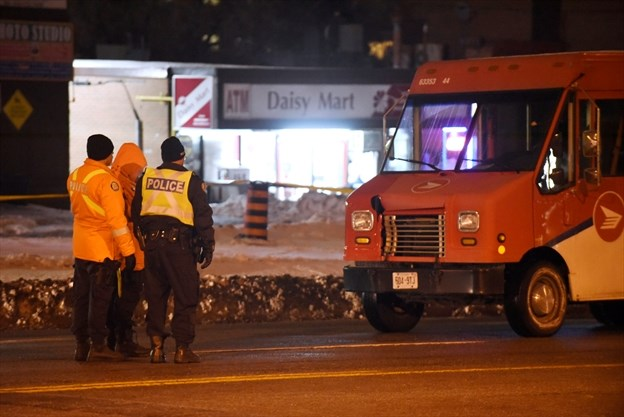 Woman, 74, dies after being hit by Canada Post truck in