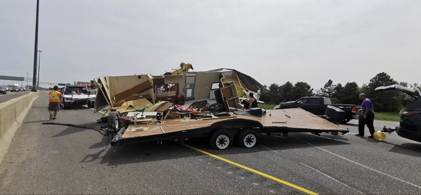 Hwy 400 cleanup near Langstaff continues after camper rollover in