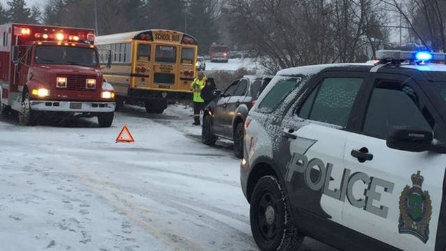 Woman airlifted to hospital after crash between school bus