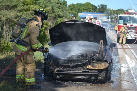 Car fire backs up Dunlop Street traffic at Hwy  400 in Barrie