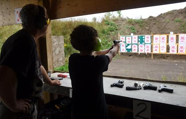 4829a838e08 Silverdale Gun Club range officer Frank Mulrooney watches Lillian  Lanzalone