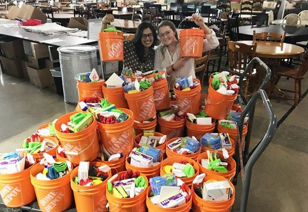 79e7f1893dd Furniture Bank s Navina Dey (left) and Lia Fedak show off some of the  buckets of cleaning supplies donated by Home Depot. - Furniture Bank photo