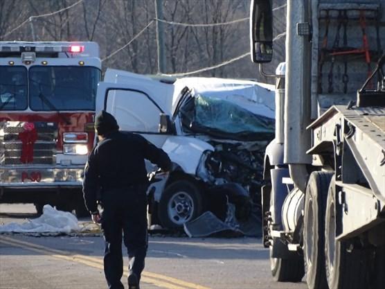 UPDATE: Man, 22, killed in collision between van, dump truck