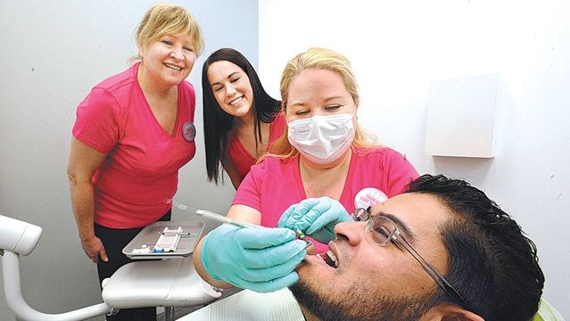 Dental hygienists give free dental care to those in need
