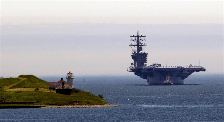 Massive us aircraft carrier steaming toward halifax for canada launched on oct 11 1975 the 86000 tonne carrier is the second oldest nimitz class vessel in the us navys fleet and has a sciox Gallery