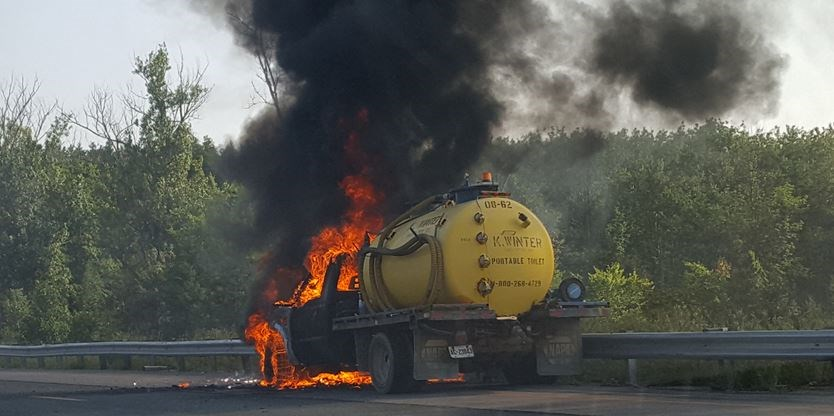 Sanitation truck catches fire on Hwy  400 in Barrie | Simcoe com