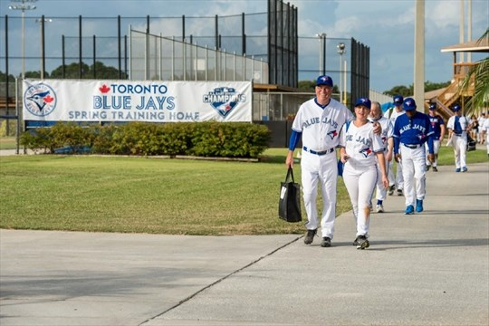b53058bd7 Ed Mann and daughter Katryne Mann lead players off the field after playing  tournament games at the Blue Jays Fantasy Camp. - Photo courtesy of The  Toronto ...