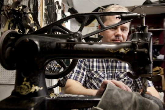5247f415d2 Victor Pfeifer stitches a shoe at his antique, pedal-powered, Singer sewing  machine. Pfeifer operates out of his Duke Street shop in Kitchener, ...