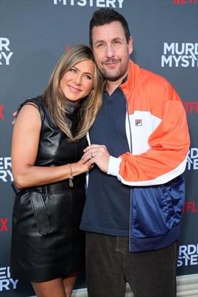 Adam Sandler's wife gave him kissing tips on set of