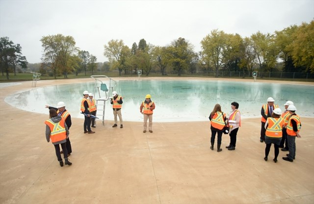City Of Kitchener Staff Joined Construction Staff To Look Over The Kiwanis  Pool During A Sneak Peek At Kiwanis Pool.   David Bebee,Record Staff
