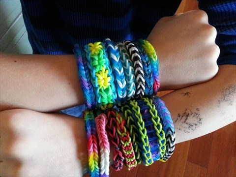 Cooper Volkman 8 Years Old Wears Loom Band Bracelets That He Made When Kids Collected Silly Bands Pas Groaned But The Cur Craze For