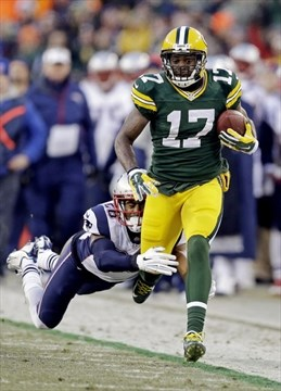 91b1dae97 Packers  Davante Adams tries to break away from New England Patriots  Logan  Ryan during the first half of an NFL game Sunday in Green Bay
