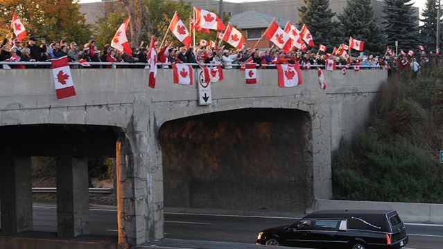 patriots pay tribute on highway of heroes for murdered