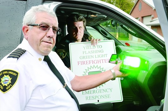 East Gwillimbury Fire Department Volunteer Terry Foster (right) And Chief  Ken Beckett Urge Motorists To Yield To Vehicles Equipped With Flashing  Green ...
