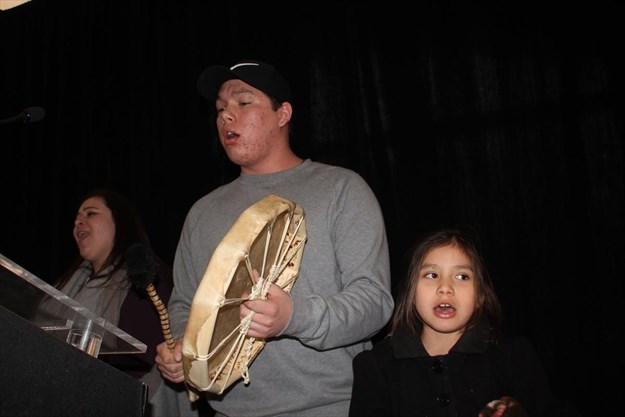 Joseph Shawana, centre, leads a round dance with his younger sister Alexis Shawana and Jill Isaacs, following the announcement of two new educational programs for Indigenous youth in Niagara. - Allan Benner , The St. Catharines Standard
