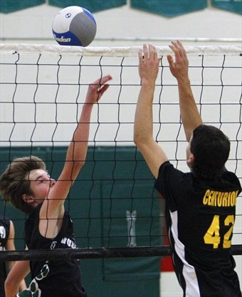 6c4d8ccc0731 Adam Scott Lions  Jacob Bergin tips the ball against Central Hastings  Centurians  Brady McCann during COSSA AA junior boys  volleyball  championship action ...
