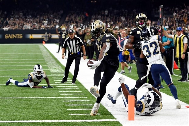1a279986e New Orleans Saints running back Alvin Kamara scores a touchdown in the first  half of an NFL game against the Los Angeles Rams in New Orleans on Sunday.