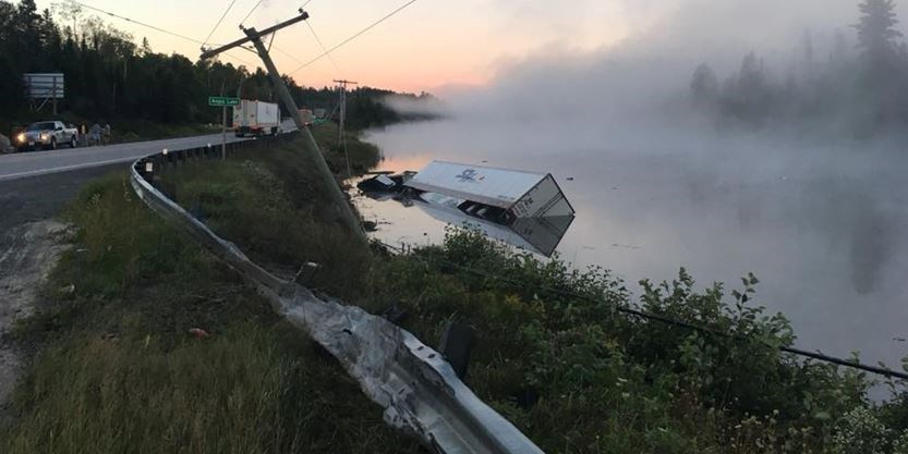 Hwy 11 crash at Temagami results in a truck in the lake