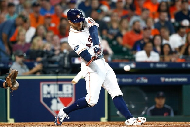 fd9fcd9d3 George Springer of the Houston Astros hits a solo home run off of Corey  Kluber of the Cleveland Indians in the fifth inning. - Bob Levey