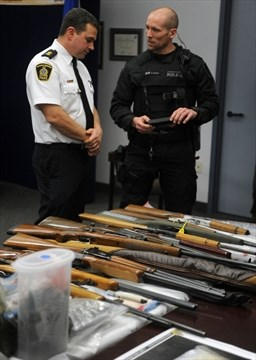 33 face more than 200 charges in drug, gun raids