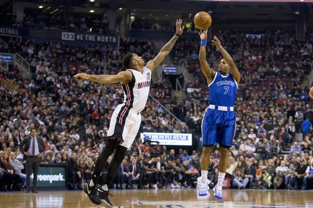 ba9aec32c29 Raptors' Kyle Lowry, right, shoots over Rodney McGruder of the Miami Heat in  the first half at the Air Canada Centre in Toronto on Friday night.