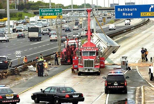 Two truck rollovers cause commuter chaos on Hwy  427 | Toronto com