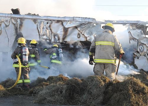 Fire on truck carrying 400 hay bales shuts down County Road