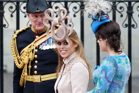 Princess Beatrice of York (left) with her sister Princess Eugenie of York  arrive to attend the Royal Wedding of Prince William to Catherine Middleton  at ... e6ade439fcc7