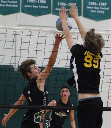 9081066a7eca Adam Scott Lions  Jacob Bergin tips the ball against Central Hastings  Centurians  Shawn Cassidy during COSSA AA junior boys  volleyball  championship action ...