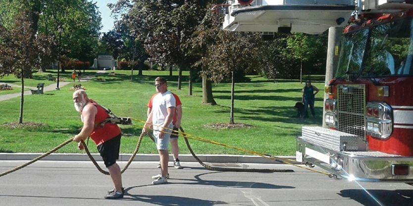 Cobourg strongman Rev  Kevin Fast breaks another Guinness