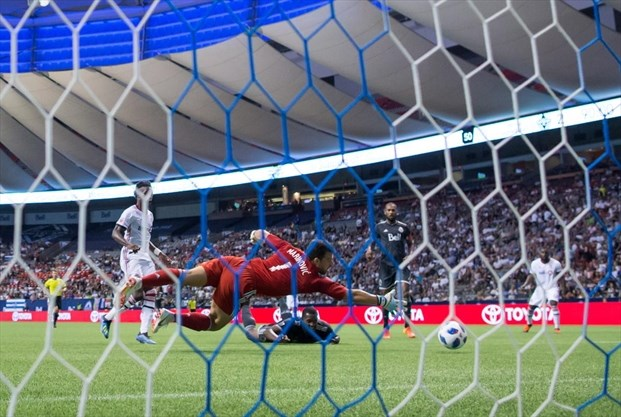e250870cf5fe08 ... watches as goalkeeper Stefan Marinovic (1) fails to prevent an own goal  by Henry at B.C. Place on Wednesday night. The extra-time tally gave Toronto  ...