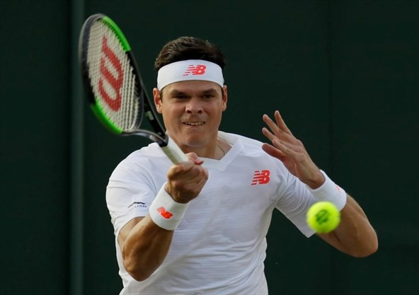 newest 3d533 4a7df Milos Raonic of Canada returns the ball to Dennis Novak of Austria during  their men s singles match on the fifth day at the Wimbledon Tennis  Championships ...