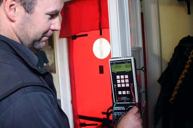 An Energy Auditor Conducts A Pre Audit Blower Door Test On A Residential  Home In Peterborough. A Blower Door Test Alerts A Homeowner To Potential ...