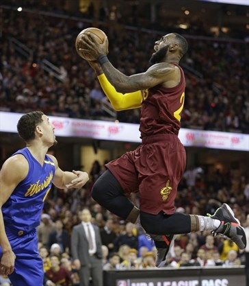 cleveland cavaliers lebron james right drives to the basket against golden state warriors klay thompson during last years christmas day game