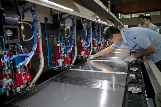 dda052d33 Ta Liang Technology tech engineer Yi Lun tests drilling machines  manufactured by the company. The firm supplies machines that are used to  create electronics ...
