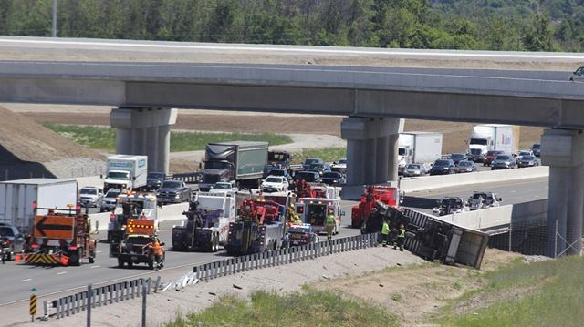 Trucker slightly injured in rollover on Hwy  401 in Ajax | Toronto com