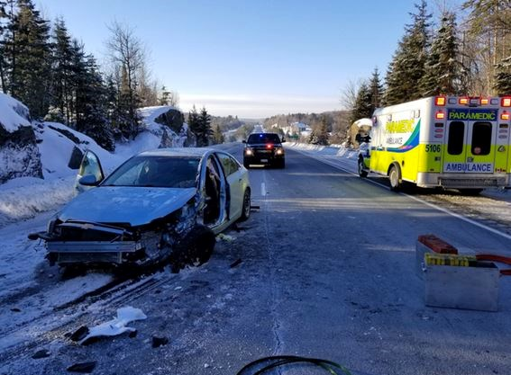 Woman injured in collision with rock cut off Highway 11