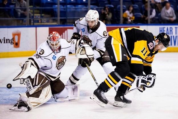 edceb005e54 The Wilkes-Barre Scranton Penguins  Jimmy Hayes ducks out of the way as the  Hershey Bears goalie Ilya Samsonov blocks a shot during an American Hockey  ...